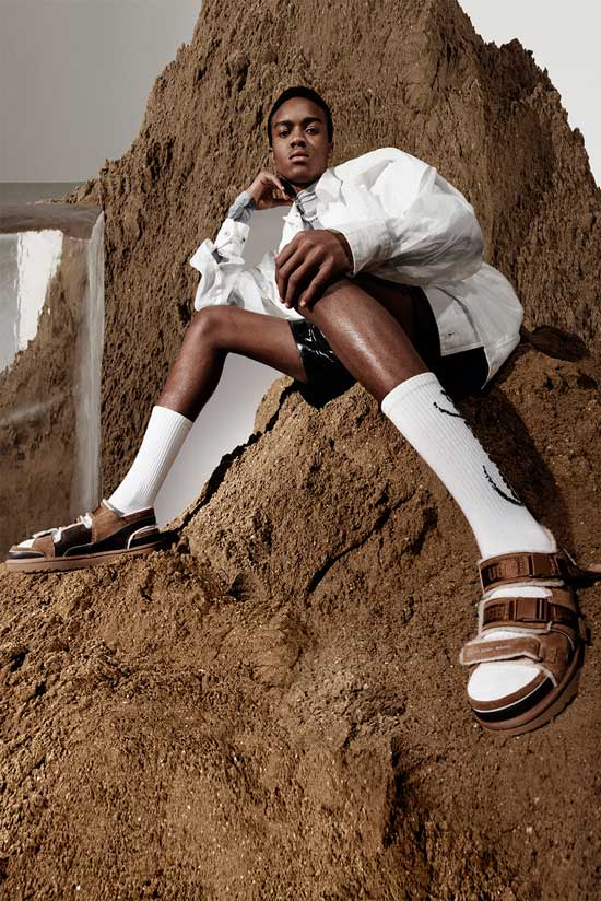 Model on a mound of dirt and block ice wearing UGG boots by Feng Chen Wang.